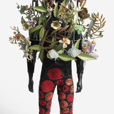 <p>Nick Cave (American, b. 1959). <i>Soundsuit</i>, 2008. Mixed media, 82 x 24 x 24 in. (208.3 x 61 x 61 cm). Brooklyn Museum, Mary Smith Dorward Fund, TL2009.6</p>