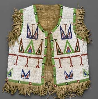<p>Sioux artist. Boy's Vest, late 19th century. Northern Plains. Hide, glass beads, 13<sup>1</sup>⁄<sub>2</sub> x 12<sup>1</sup>⁄<sub>4</sub> in. (34.3 x 31.1 cm). Brooklyn Museum, Brooklyn Museum Collection, X98</p>
