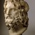 Roman. Head of Serapis, 75-150 C.E. Marble, 10 3/8 x 7 3/8 x 6 7/8 in. (26.4 x 18.7 x 17.5 cm). Brooklyn Museum, Charles Edwin Wilbour Fund, 37.1522E. Creative Commons-BY (Photo: Brooklyn Museum, 37.1522E_threequarter_left_SL1.jpg)