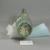 Roman. Molded Jug, 1st century C.E. Glass, 6 11/16 x 2 11/16 x 3 3/4 in. (17 x 6.9 x 9.5 cm). Brooklyn Museum, Gift of Robert B. Woodward, 01.259. Creative Commons-BY (Photo: Brooklyn Museum, CUR.01.259_bottom.jpg)