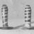 Ear Studs, ca. 1539-1075 B.C.E. Glass, 37.1438Ea: Greatest Diam. 5/8 x 1 in. (1.7 x 2.5 cm). Brooklyn Museum, Charles Edwin Wilbour Fund, 37.1438Ea-b. Creative Commons-BY (Photo: Brooklyn Museum, CUR.37.1438Ea-b_neg_grpA_bw.jpg)