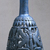 Bottle with Openwork Shell, ca. 1070-718 B.C.E. Egyptian blue, 6 11/16 x greatest diam. 2 15/16 in. (17 x 7.5 cm). Brooklyn Museum, Charles Edwin Wilbour Fund, 44.175. Creative Commons-BY (Photo: Brooklyn Museum, CUR.44.175_view5.jpg)