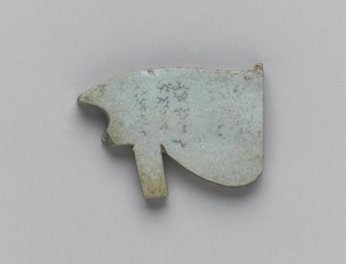 Wadjet-eye Amulet, 664-30 B.C.E. Faience, glazed, 7/8 x 15/16 x 1/8 in. (2.2 x 2.4 x 0.3 cm). Brooklyn Museum, Gift of the Egypt Exploration Fund, 02.235. Creative Commons-BY