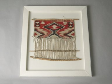 Navajo (Native American). Model of Loom, late 19th century. Wool, cotton, wood, 16 1/2 in. X 19 in. (41.9 X 48.3 cm). Brooklyn Museum, Gift of George Foster Peabody, 02.255.2253. Creative Commons-BY