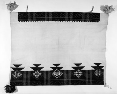 Pueblo (unidentified) (Native American). White Mantle with embroidered edges, late 19th or early 20th century. Cotton, wool, 59 1/16 x 40 3/16 in.  (150 x 102 cm). Brooklyn Museum, Brooklyn Museum Collection, 03.219. Creative Commons-BY