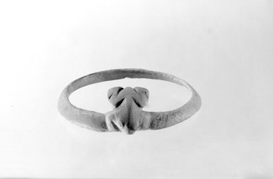 Hohokam (Native American). Carved Frog-shaped Bracelet, 1100-1300. Clam Shell, 5/16 x 3 1/4 in. (0.8 x 8.3 cm). Brooklyn Museum, Museum Expedition 1903, Museum Collection Fund, 03.325.4155. Creative Commons-BY