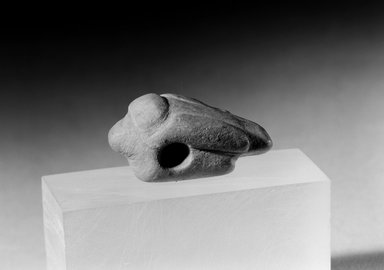 Ancient Pueblo (Anasazi) (Native American). Grey, Incised, Perforated Bird-shaped Charm, 600-1300. Stone, 1 3/8 x 9/16 x 5/8 in. (3.5 x 1.4 x 1.6 cm). Brooklyn Museum, Museum Expedition 1903, Museum Collection Fund, 03.325.4455. Creative Commons-BY