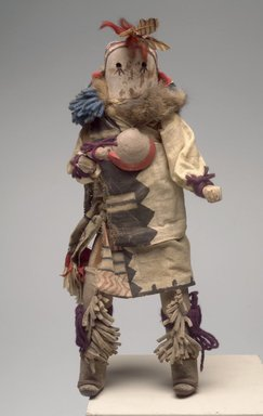 She-we-na (Zuni Pueblo) (Native American). Kachina Doll (Kjaklo), late 19th century. Wood, textile, leather, fur, feathers, pigment, shell, 14 1/2 x 6 x 4 1/4 in. (36.8 x 15.2 x 10.8 cm). Brooklyn Museum, Museum Expedition 1903, Museum Collection Fund, 03.325.4614. Creative Commons-BY
