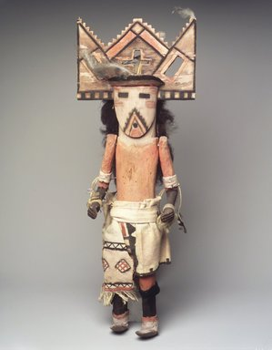 She-we-na (Zuni Pueblo) (Native American). Kachina Doll (Thlamatona), late 19th century. Wood, pigment, hair, feathers, yarn, cotton cloth, 20 x 7 x 6 in. (50.8 x 17.8 x 15.2 cm). Brooklyn Museum, Museum Expedition 1903, Museum Collection Fund, 03.325.4620. Creative Commons-BY