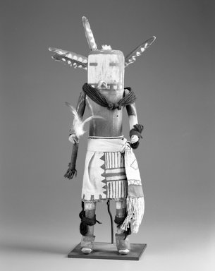 She-we-na (Zuni Pueblo) (Native American). Kachina Doll (Towitsinapa), late 19th century. Wood, cloth, yarn, string, feathers, hide, pigment, nails, metal, 17 5/16 x 4 3/4 x 6in. (44 x 12 x 15.2cm). Brooklyn Museum, Museum Expedition 1903, Museum Collection Fund, 03.325.4627. Creative Commons-BY
