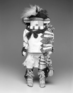She-we-na (Zuni Pueblo) (Native American). Kachina Doll (Hututu), late 19th  century. Wood, pigment, fur, cotton textile, feathers, leather, yarn, 16 x 5 1/2 x 5 1/2 in. (40.6 x 14.0 x 14.0 cm). Brooklyn Museum, Museum Expedition 1903, Museum Collection Fund, 03.325.4629. Creative Commons-BY
