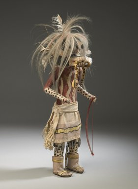 She-we-na (Zuni Pueblo) (Native American). Kachina Doll (Hilili Kohanna), late 19th century. Wood, pigment, horse hair, hide, cotton, feathers, tin, 20 x 6 1/2 x 5 1/2 in. (50.8 x 16.5 x 14 cm). Brooklyn Museum, Museum Expedition 1903, Museum Collection Fund, 03.325.4648. Creative Commons-BY