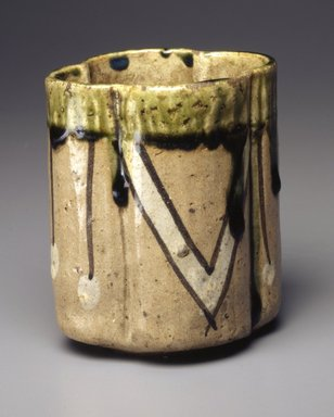 Cup, early 17th century. Mino ware in Oribe style: buff stoneware with iron-brown and white-slip painted designs under a clear glaze, top dipped in green glaze., 3 3/4 x 3 5/16 in.  (9.5 x 8.4 cm). Brooklyn Museum, Gift of Robert B. Woodward, 03.87. Creative Commons-BY