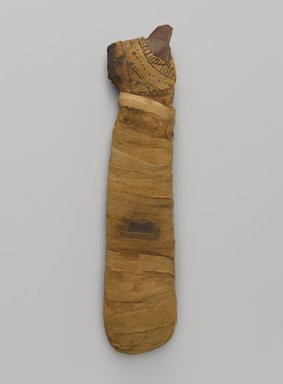 Cat Mummy, 305 B.C.E.-395 C.E. Animal remains, linen, painted, 2 1/2 x 3 1/2 x 14 1/2 in. (6.4 x 8.9 x 36.8 cm). Brooklyn Museum, Charles Edwin Wilbour Fund, 05.307. Creative Commons-BY