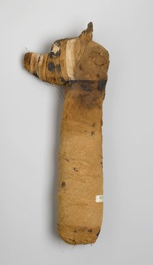 Dog Mummy, 305 B.C.E.-395 C.E. Animal remains, linen, painted, 3 1/4 x 18 x 7 in. (8.3 x 45.7 x 17.8 cm). Brooklyn Museum, Charles Edwin Wilbour Fund, 05.308. Creative Commons-BY