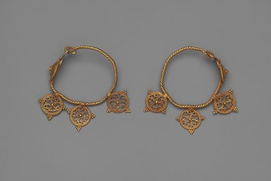 Earrings with Open Work Wheels, 6th century C.E. Gold, each earring: 2 3/8 x 9/16 in. (6 x 1.5 cm). Brooklyn Museum, Ella C. Woodward Memorial Fund, 05.439a-b. Creative Commons-BY