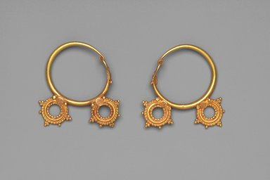 Earrings with Two Wheel Ornaments, 6th century C.E. Gold, .440a: 1 7/16 x 1 3/8 x 5/16 in. (3.7 x 3.5 x 0.8 cm). Brooklyn Museum, Ella C. Woodward Memorial Fund, 05.440a-b. Creative Commons-BY