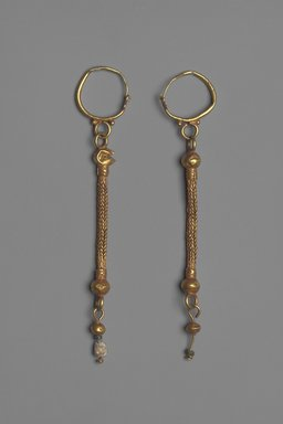 Earrings with Composite Pendants, 6th-7th century C.E. Gold, glass, and pearl, 05.464a: 4 9/16 in. (11.6 cm). Brooklyn Museum, Ella C. Woodward Memorial Fund, 05.464a-b. Creative Commons-BY