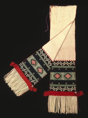 Hopi-Tewa Pueblo (Native American). Dance Sash with Possible Representation of Broadface Kachina Mask, late 19th century. Cotton, wool yarn, 86 x 16 in. (218.4 x 40.6 cm). Brooklyn Museum, Museum Expedition 1905, Museum Collection Fund, 05.588.7167. Creative Commons-BY