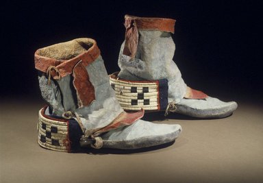 Hopi Pueblo (Native American). Dancing Shoes, late 19th century. Deer hide, pigments, sinew, porcupine quill, horse hair, wool, 10 3/16 x 4 5/16 x 7 5/16 in. (25.9 x 11 x 18.6 cm). Brooklyn Museum, Museum Expedition 1905, Museum Collection Fund, 05.588.7175a-b. Creative Commons-BY