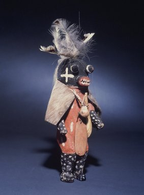 Hopi Pueblo (Native American). Kachina Doll, late 19th century. Wood,pogment fur, cotton, horsehair, feather, shell, horn, stone, 12 1/4 x 5 x 3 in. (31.1 x 12.7 x 7.6 cm). Brooklyn Museum, Museum Expedition 1905, Museum Collection Fund, 05.588.7193. Creative Commons-BY
