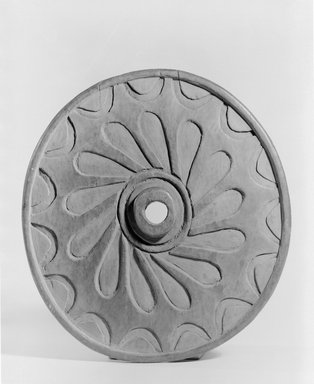 Chemainus, Coast Salish (Native American). Spindle Whorl (Sulsultin) Carved with Wheel Design, late 19th century. Cedar wood, 8 7/8 x 9 1/4 in. (22.5 x 23.5 cm). Brooklyn Museum, Museum Expedition 1905, Museum Collection Fund, 05.588.7384. Creative Commons-BY