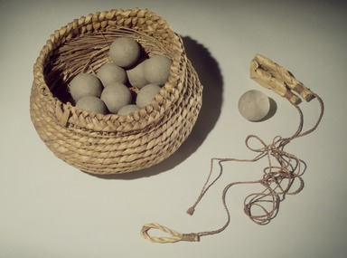 Pen Graves (Pomo, Native American). 10 Balls used for Killing Marsh Hens  (ta-ma-whille), ca. 1906. Clay, plant fiber, Diameter: 1 1/2 in. (3.8 cm). Brooklyn Museum, Museum Expedition 1908, Museum Collection Fund, 08.491.8581. Creative Commons-BY