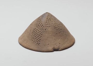 Conical Lid, ca. 3300-3100 B.C.E. Pottery, height: 2 1/8 in. (5.4 cm); greatest diam.: 4 1/8 in. (10.5 cm) . Brooklyn Museum, Charles Edwin Wilbour Fund, 07.447.485. Creative Commons-BY