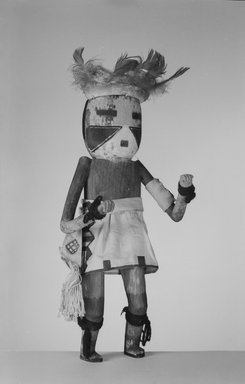 She-we-na (Zuni Pueblo) (Native American). Kachina Doll (Eka Ya Tosh Na-kwe), late 19th century. Wood, cloth, hide, feathers, string, pigment, wool, 14 3/8 x 5 7/8 x 3 7/8 in. (36.5 x 14.9 x 9.8 cm). Brooklyn Museum, Museum Expedition 1907, Museum Collection Fund, 07.467.8396. Creative Commons-BY