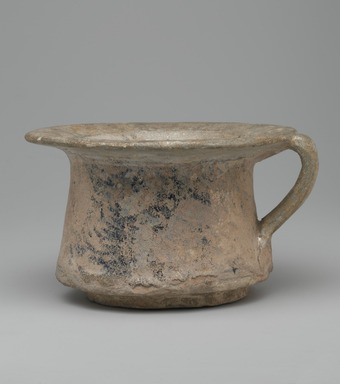 Mesopotamian. Cup, 14th century. Ceramic; fritware, painted in black and cobalt blue under a transparent glaze; heavy iridescence; rim and handle repaired, 4 x 6 7/8 in. (10.2 x 17.5 cm). Brooklyn Museum, Museum Collection Fund, 08.23. Creative Commons-BY