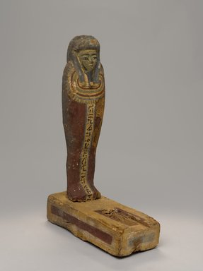 Osiris Figurine, after 305 B.C.E. Wood, paint, 15 x 3 1/2 x 9 in. (38.1 x 8.9 x 22.9 cm). Brooklyn Museum, Charles Edwin Wilbour Fund, 08.480.203. Creative Commons-BY