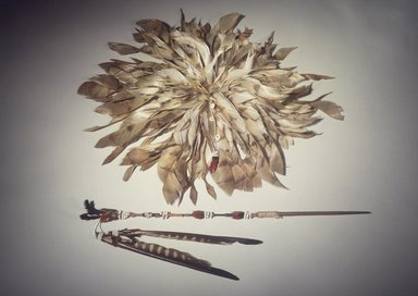 George Barber (Maidu, Native American, 1833-1918). Head Plume (Wai-yet-ti), late 19th-early 20th century. Barn owl feathers, acorn woodpecker scalp, clamshell beads, glass beads, cotton string, 3 1/8 x 13 3/4 in. (7.9 x 34.9 cm). Brooklyn Museum, Museum Expedition 1908, Museum Collection Fund, 08.491.8807. Creative Commons-BY