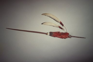 Maidu (Native American). Ceremonial Pin (Di-Yo), late 19th-early 20th century. Manzanita wood, pileated and acorn woodpecker scalp, swan feathers, glass beads, cotton string, 3 x 19 1/4 in. (7.6 x 48.9 cm). Brooklyn Museum, Museum Expedition 1908, Museum Collection Fund, 08.491.8812. Creative Commons-BY