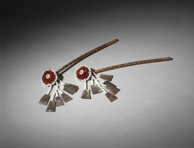 Mary Kea'a'ala Azbill (Maidu, Native American, 1864-1932). Ear Bones (Bo-no), late 19th-early 20th century. Crane wing bones, sedge root, acorn woodpecker scalp, feathers, glass beads, commercial string, abalone shell, 9 x 1 1/2 in. (22.9 x 3.8 cm). Brooklyn Museum, Museum Expedition 1908, Museum Collection Fund, 08.491.8826a-b. Creative Commons-BY