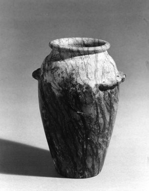 Wavy-handled Jar, ca. 3650-3550 B.C.E. Serpentine, 5 9/16 x 3 15/16 x 3 15/16 in. (14.1 x 10 x 10 cm). Brooklyn Museum, Charles Edwin Wilbour Fund, 09.889.31. Creative Commons-BY