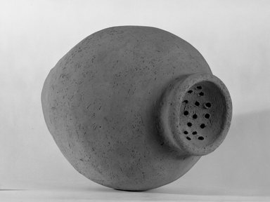 Ovoid Shaped Strainer Jar, ca. 3300-3100 B.C.E. Terracotta, slip, 14 x 10 1/16 x 10 1/16 in. (35.5 x 25.5 x 25.5 cm). Brooklyn Museum, Charles Edwin Wilbour Fund, 09.889.650. Creative Commons-BY
