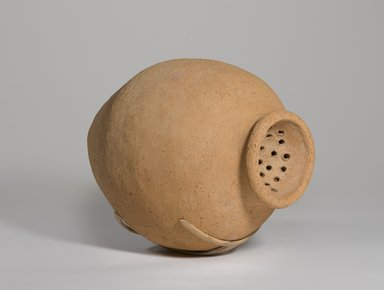 Ovoid-Shaped Strainer Jar, ca. 3300-3100 B.C.E. Terracotta, slip, 14 x 10 1/16 x 10 1/16 in. (35.5 x 25.5 x 25.5 cm). Brooklyn Museum, Charles Edwin Wilbour Fund, 09.889.650. Creative Commons-BY