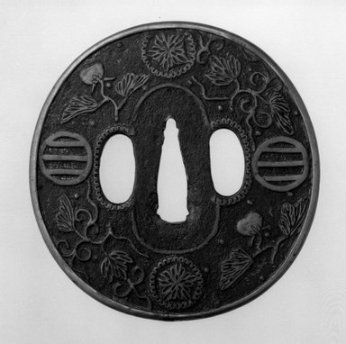 Sword Guard, 17th century. Iron with brass inlay; copper sekigane, 3 1/4 x 3 1/8 in. (8.2 x 8 cm). Brooklyn Museum, Museum Expedition 1909, Purchased with funds given by Thomas T. Barr, E. LeGrand Beers, Carll H. de Silver, Herman B. Stutzer, Colonel Robert B. Woodward and the Museum Collection Fund, 09.915.13. Creative Commons-BY
