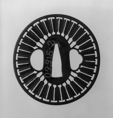 Sword Guard, 18th-19th century. Iron, copper, 2 15/16 x 2 13/16 in. (7.5 x 7.1 cm). Brooklyn Museum, Museum Expedition 1909, Purchased with funds given by Thomas T. Barr, E. LeGrand Beers, Carll H. de Silver, Herman B. Stutzer, Colonel Robert B. Woodward and the Museum Collection Fund, 09.915.2. Creative Commons-BY