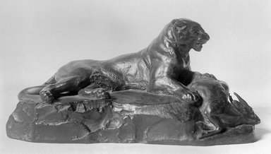 Antoine-Louis Barye (French, 1795-1875). Reclining Panther Holding a Muntjac Deer (Panthère couchée tenant un cerf muntjac), n.d. Bronze, 4 1/4 x 8 1/2 x 3 3/4 in. (10.8 x 21.6 x 9.5 cm). Brooklyn Museum, Purchased by Special Subscription, 10.159. Creative Commons-BY