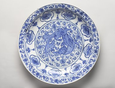 Dish Depicting a Coiled Dragon, late 17th century. Ceramic; stone paste, painted in cobalt blue under a transparent colorless glaze, Diam. 16 5/16 in. (41.4 cm). Brooklyn Museum, Museum Collection Fund, 11.33. Creative Commons-BY