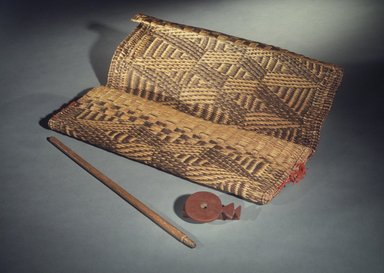 Osage (Native American). Medicine Bag with Pipe, late 19th - early 20th century. Rush, native dyes, red wool, catlinite, wood (ash), Pipe: 4 1/2 x 3 in. Brooklyn Museum, Museum Expedition 1911, Museum Collection Fund, 11.694.9043a-c. Creative Commons-BY