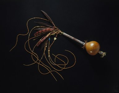 Osage (Native American). Peyote Rattle, late 19th-early 20th century. Gourd, glass beads, metal, feathers, brass, sinew, nut or seed, cork, 27 9/16 x 2 3/4 in. (70 x 7 cm). Brooklyn Museum, Museum Expedition 1911, Museum Collection Fund, 11.694.9059. Creative Commons-BY