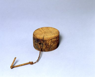 Ainu. Round Block. Wood, 2 13/16 x 4 15/16 in. (7.2 x 12.5 cm). Brooklyn Museum, Gift of Herman Stutzer, 12.140. Creative Commons-BY