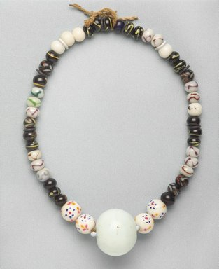 Ainu. Necklace. Beads, 1 3/8 x 20 1/2 in. (3.5 x 52 cm). Brooklyn Museum, Gift of Herman Stutzer, 12.447. Creative Commons-BY