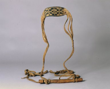 Ainu. Baby Sling. Flat plaited grass baby sling.  Broad band at center with black geometric decoration.  Long wooden handle sling attached to each end of handle. Condition: grass worn., 1 5/16 x 13 9/16 in. (3.3 x 34.4 cm). Brooklyn Museum, Gift of Herman Stutzer, 12.492. Creative Commons-BY