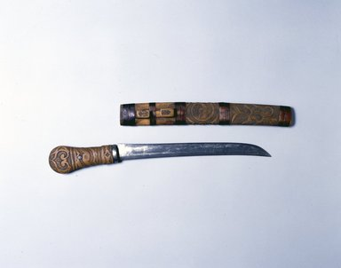 Ainu. Sword with Carved Handle, late 19th-early 20th century. Wood, knife in sheath: 1 9/16 x 1 1/2 x 19 7/8 in. (4 x 3.8 x 50.5 cm). Brooklyn Museum, Gift of Herman Stutzer, 12.497a-b. Creative Commons-BY