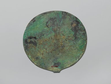 Mirror Disk. Copper, 5 1/16 in. (12.8 cm). Brooklyn Museum, Gift of the Egypt Exploration Society, 12.911.7. Creative Commons-BY