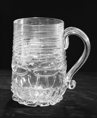 Molded Mug with Handle, ca. 1690. Glass, 6 1/8 x 3 3/4 in. (15.6 x 9.5 cm). Brooklyn Museum, Purchased by Special Subscription and Museum Collection Fund, 13.707. Creative Commons-BY