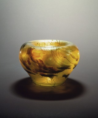 Bowl, ca. 1901-1905. Favrile glass, 7 x 10 x 10 in. (17.8 x 25.4 x 25.4 cm). Brooklyn Museum, Gift of Charles W. Gould, 14.739.14. Creative Commons-BY